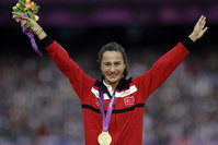 In this Aug. 11, 2012 file photo Turkey's Asli çakir Alptekin poses with her gold medal for the women's 1500-meter during the athletics in the Olympic Stadium at the 2012 Summer Olympics, London (AA Photo).