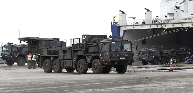 German Army 'Patriot' defence missile system trucks disembark from a Suecia Seeways ferry ship in Iskenderun Harbour, Hatay, Turkey 21 January 2013, as part of a NATO deployment (EPA photo)