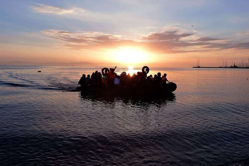 A dinghy overcrowded with Syrian refugees approaches a beach on the Greek island of Kos after crossing a part of the Aegean Sea from Turkey to Greece.