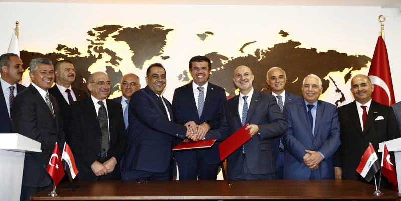 Economy Minister Zeybekci (C) participated in the Turkey-Iraq Business Council's re-establishment ceremony with DEu0130K Chairman Vardan (center R) and Chairman of Federation of Iraqi Chambers of Commerce Al-Hamadani (center L).
