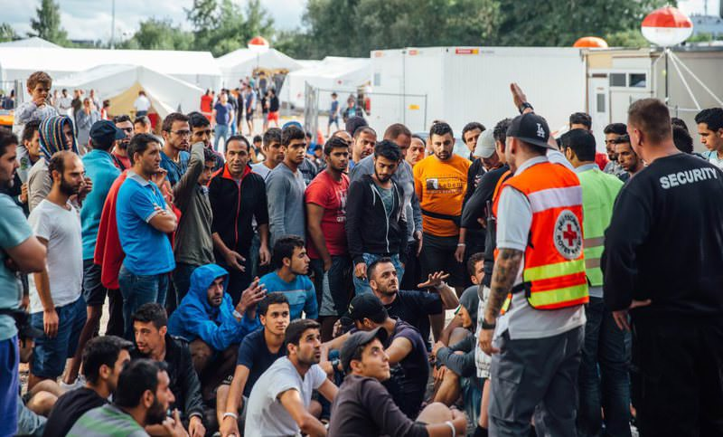 Refugees gather for a sit-in at the entrance of refugee camp in Dresden, Germany
