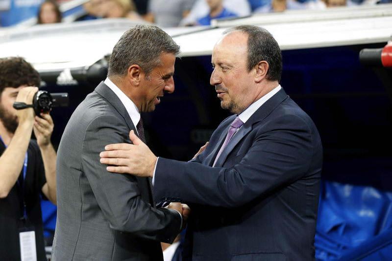Real Madrid's head coach Rafa Benitez (R) greets Galatasaray's head coach Hamza Hamzaoglu (L) before the Santiago Bernabeu Trophy.