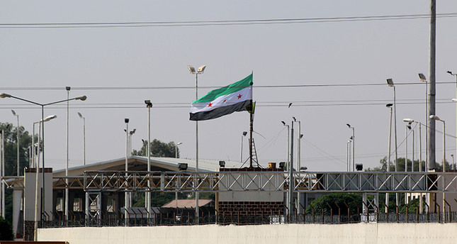 A flag of the Free Syrian Army raised over Tal Abyad (AA Photo)
