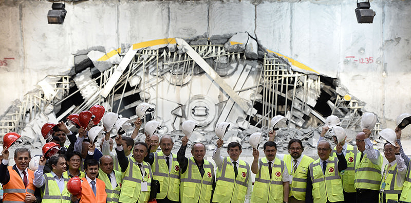 Prime Minister Ahmet Dauvtou011flu marks the end of the digging process for the 5.4 km long tunnel along with construction managers, ministers and Istanbul's mayor (AA Photo)