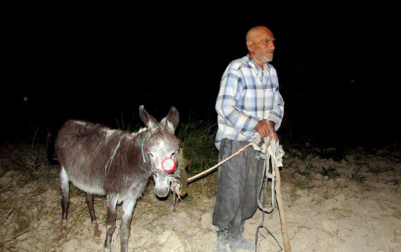 Hamo Demir with his donkey (u0130HA photo)