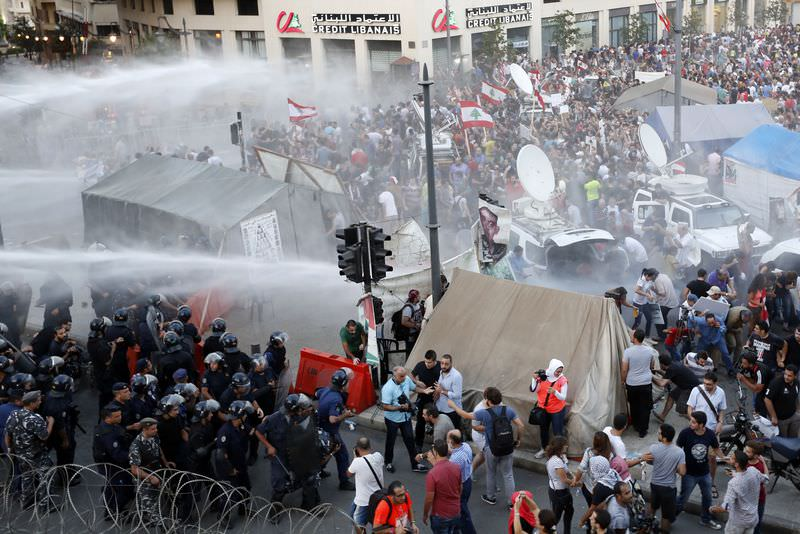 Lebanese police use water cannons to disperse ,You Stink, protesters campaigning against the trash crisis in Beirut on August 22, 2015. (AFP Photo)