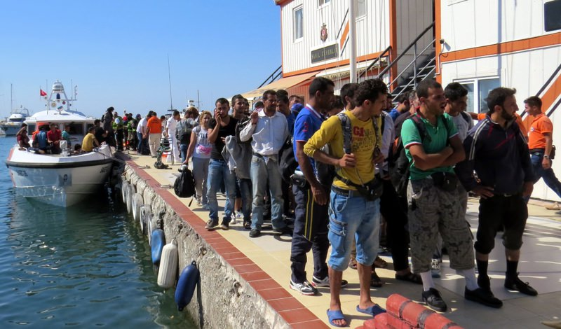 Migrants, whose boat was reportedly deflated by Greek Coast Guard, arrived at a Turkish port after they were rescued by Turkish fishermen on Aug. 13.