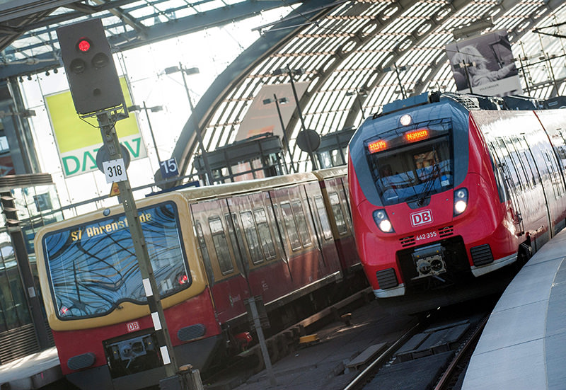 An S-bahn and regional train stand at the main train station in Berlin, Germany, 21 May 2015 (EPA photo).
