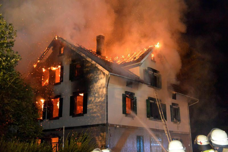 Firefighters battle flames engulfing a house that was destined as housing for migrants in Weissach im Tal, Baden-Wuerttemberg state, Germany on Aug. 24.