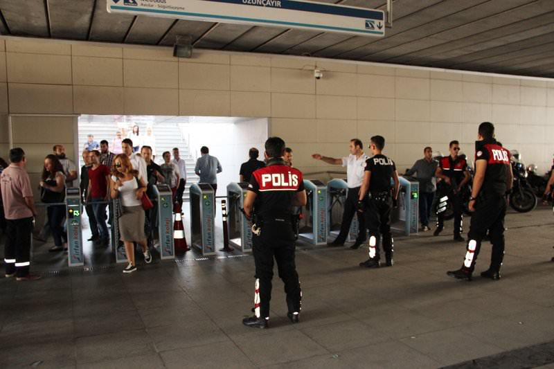 Turkish police doing a criminal record check in Istanbul Uzunçayır metrobus station on August 26, 2015. (IHA Photo)