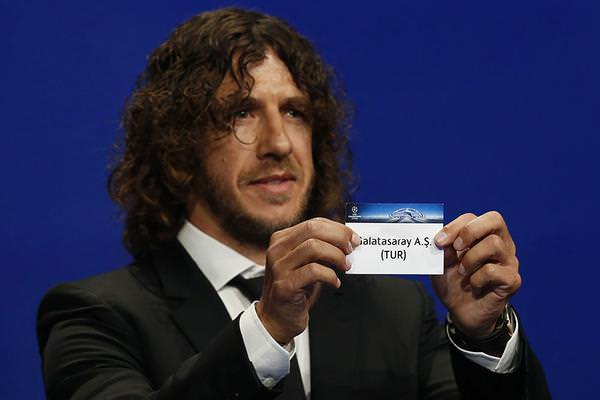 Former Spanish football player Carlos Puyol shows the name of Galatasaray football club during the UEFA Champions League Group stage draw ceremony, on August 27, 2015 in Monaco. (AFP Photo)