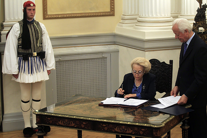 Greece's caretaker Prime Minister Vassiliki Thanou signs the protocol of the swearing-in ceremony of the new government's caretaker ministers (EPA Photo)