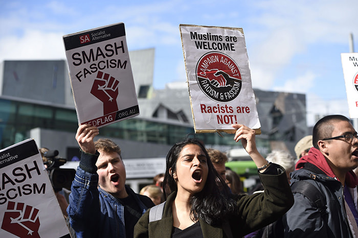 Protesters rally and block traffic outside Flinders Street Station against the Australian Border Force's (ABF) Operation Fortitude in Melbourne, Australia (EPA Photo)
