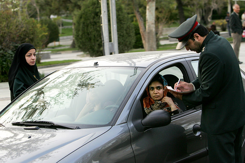 A file picture taken on April 22, 2007 shows Iranian police officers stopping a car during a crackdown to enforce the dress code in the north of Tehran (AFP photo).