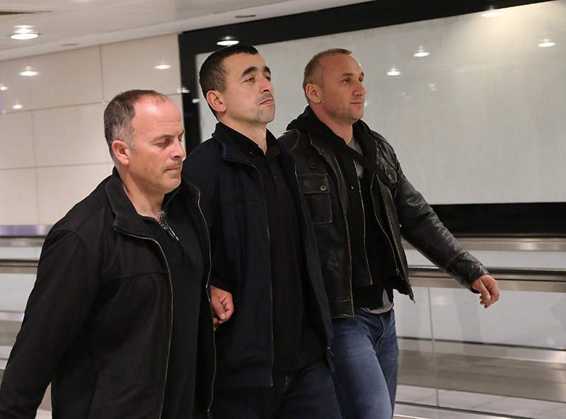 Former police chief Sedat Zavar (middle), who is accused of wiretapping Erdou011fanu2019s office was extradited by Romania after Turkey sent the investigation file (IHA Photo)