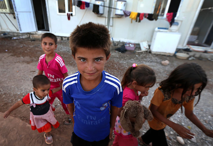 A young Iraqi boy who fled the violence in the northern city of Tal Afar poses for a photo (AFP Photo)