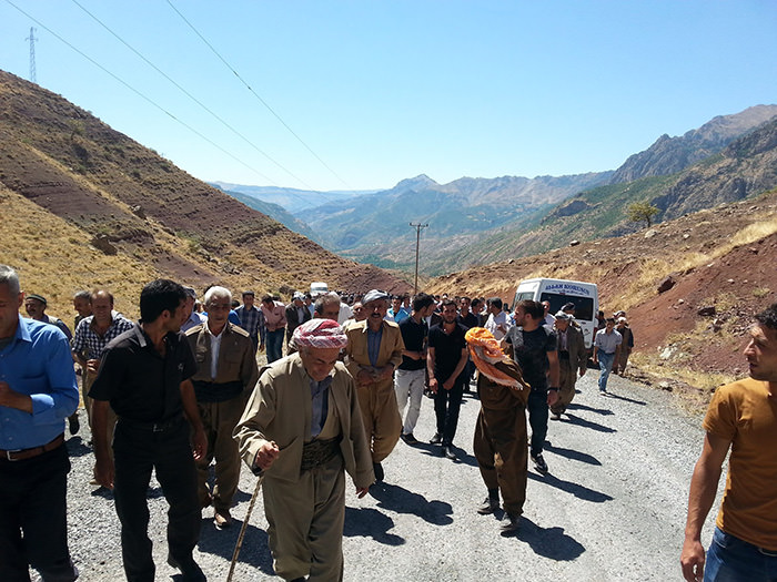 A group of people protests PKK destroying bridge in u015eemdinli district of Hakkari province (DHA Photo)