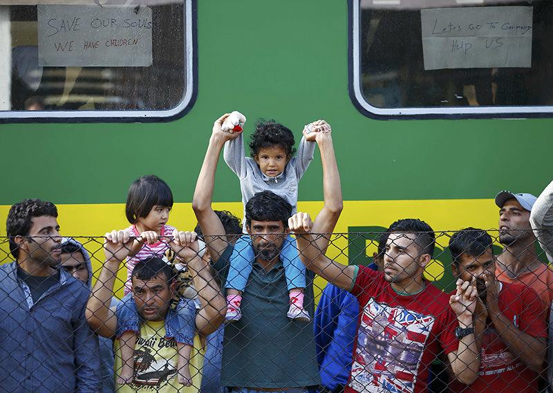 Refugees stand alongside a train at Bicske railway station, Hungary, September 4, 2015 (Reuters Photo)