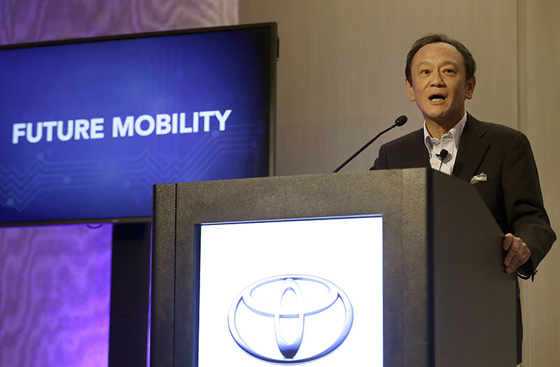 Toyota announced it is investing $50 million with Stanford University and the Massachusetts Institute of Technology in hopes of gaining an edge in an accelerating race to phase out human drivers.