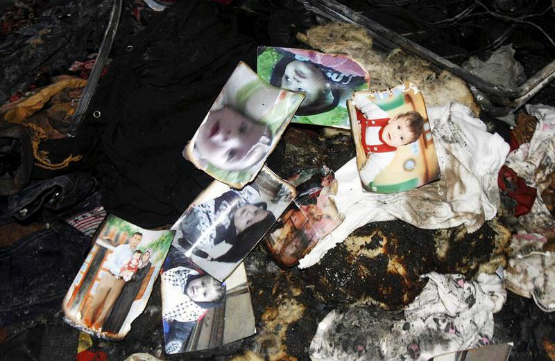 Photos of a one-and-a-half year old boy, Ali Dawabsheh, lie in a house that had been torched in an arson attack by Jewish settlers.