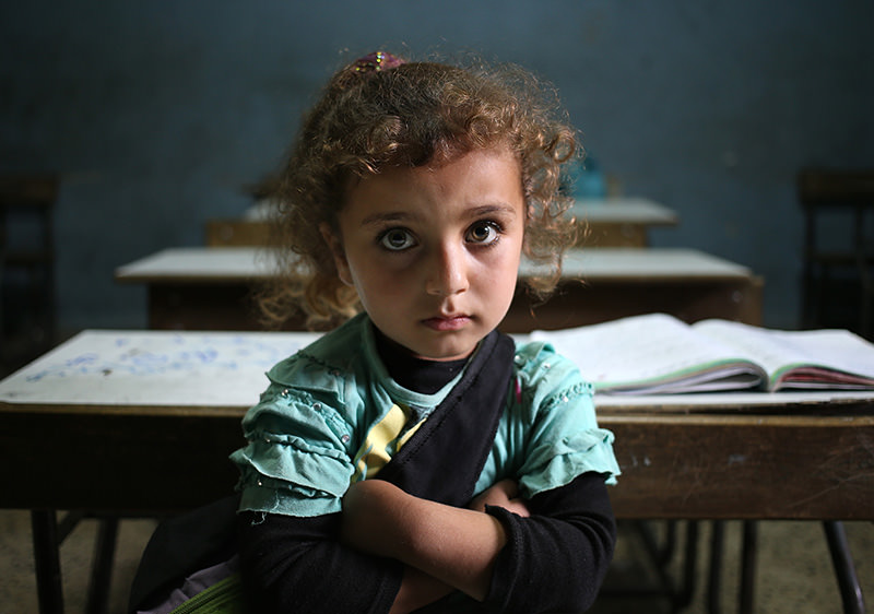 In this Thursday, May 29, 2014 file photo, a Syrian refugee girl sits in a classroom at a Lebanese public school where only Syrian students attend classes in the afternoon, at Kaitaa village in north Lebanon (AP photo).