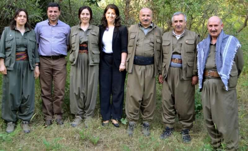 HDP Co-Chair Selahattin Demirtau015f (2nd L) and HDP deputy Pervin Buldan (C) pose with senior PKK leaders at a camp on Qandil Mountain.