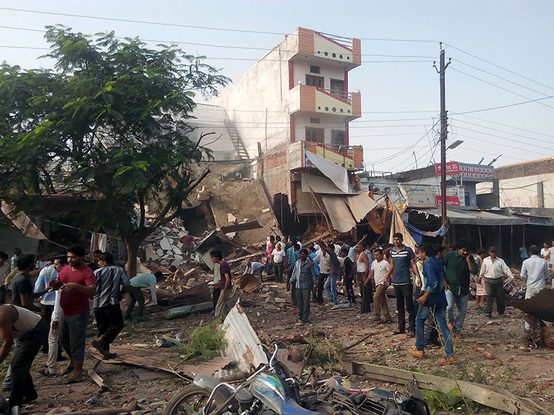 People gather around the site of an explosion at a restaurant in Jhabua district in the central Indian state of Madhya Pradesh (AFP Photo)