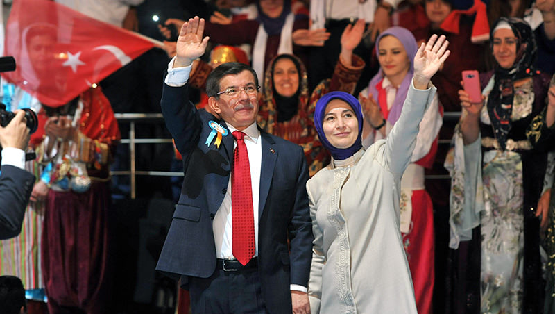 PM Ahmet Davutou011flu (L) and his wife Sare greet their supporters as they arrive to attend the 5th edition of the AK Party annual congress in Ankara, on September 12, 2015 (AFP Photo)