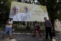 ubans walk under a poster of Pope Francis, which reads Welcome to Cuba in Havana September 14, 2015. Pope Francis will be visiting Cuba from September 19 to September 22. (Reuters Photo)