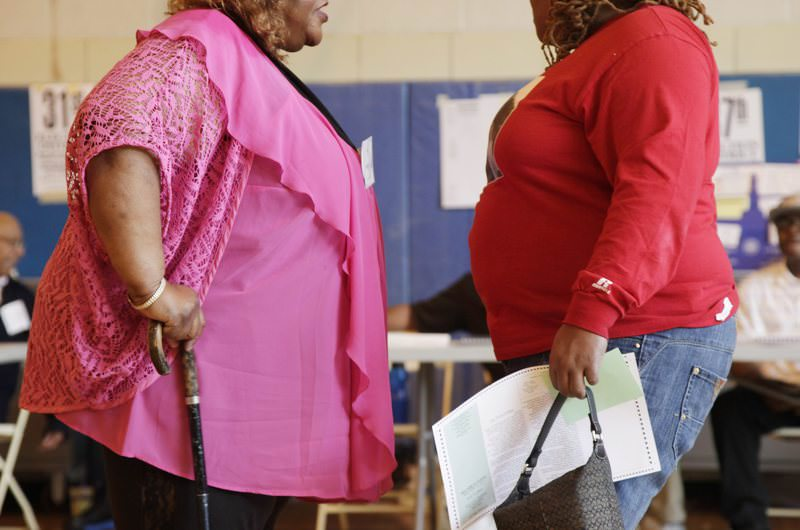 In this file photo dated Tuesday, June 26, 2012, two overweight women hold a conversation in New York, USA. (AP Photo)