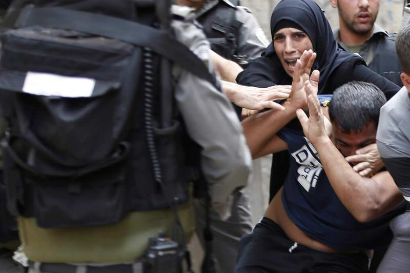 Palestinians scuffle with Israeli riot police after security forces blocked a road leading to Al-Aqsa Mosque compound.