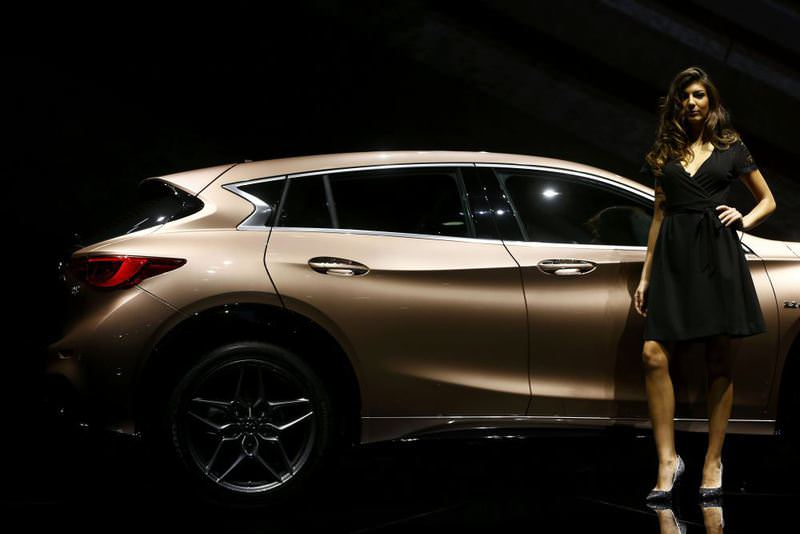A model poses with an Infiniti Q30 during the media day of the Frankfurt Motor Show.