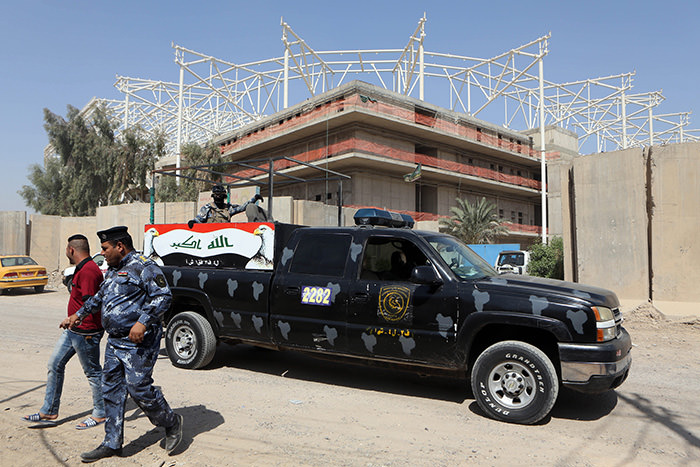 Iraqi security forces guard the entrance to a sports complex being built by a Turkish construction company, in the Shiite district of Sadr City, Baghdad, Iraq, Wednesday, Sept. 2, 2015 (AP Photo)