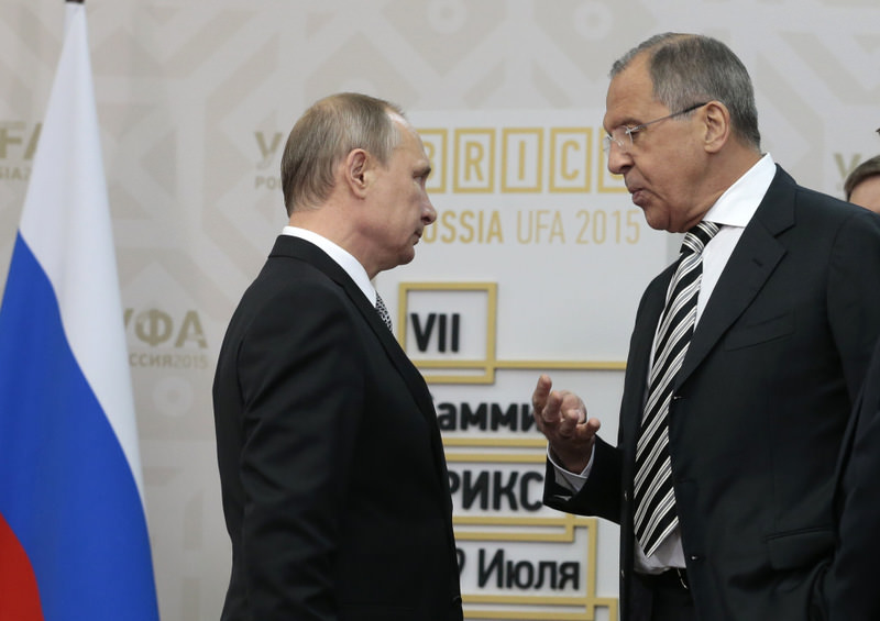 Russian President Vladimir Putin speaks with Foreign Minister Sergey Lavrov (R) in Ufa, Russia on July 8.