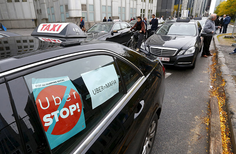 Taxi drivers from all over Europe line a street during a protest against online ride-sharing company Uber, in central Brussels, Belgium, September 16, 2015. (Reuters Photo)