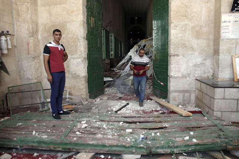 The gate of Al-Aqsa Mosque was destroyed in Israeli attacks.