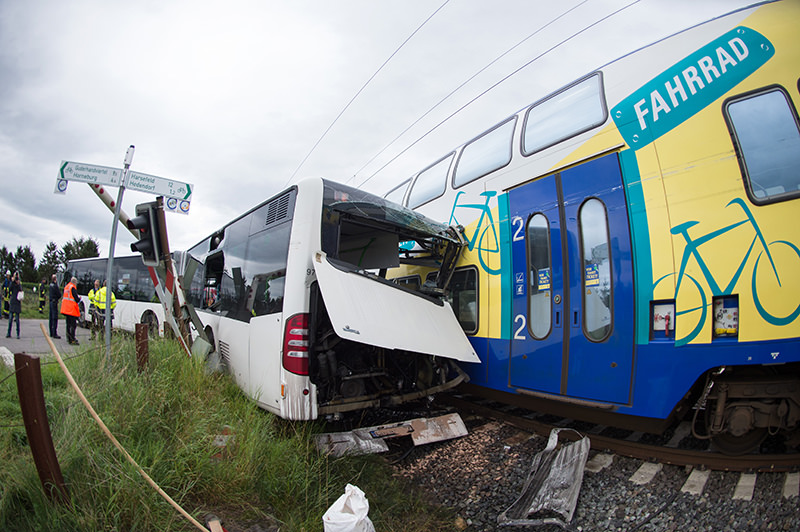 The wreckage of a school bus and a train stand on a railway crossing near Buxtehude, northern Germany, Wednesday, Sept. 16, 2015 (AP Photo)