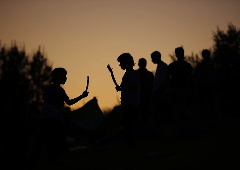 Children, mostly Syrians, trying to reach Europe play outside the Turkish city of Edirne, which borders European Union members Greece and Bulgaria (AP Photo)