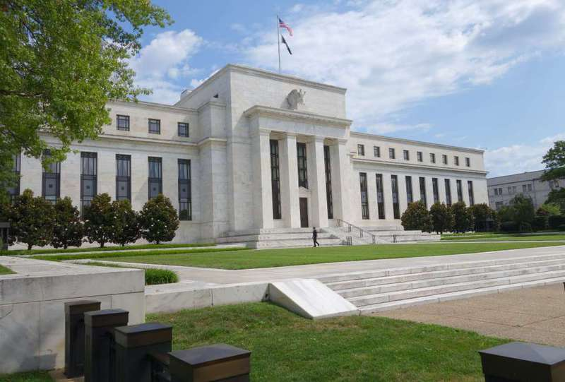 This Aug. 1, 2015 file photo shows the US Federal Reserve building in Washington, DC. Even if the Fed does raise its benchmark short-term rate, no one expects a sharp or rapid sequence of hikes.