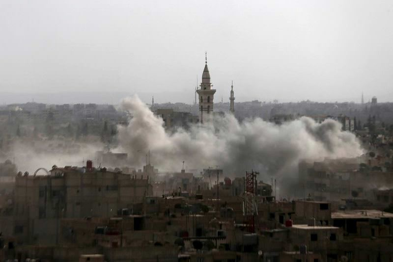 Smoke rises after the Syrian air force bombed Douma, a suburb of the capital, Damascus. Civilians suffer from heavy bombings which are carried out largely with equipment supplied by Russia.