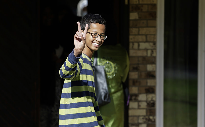 Ahmed Mohamed, 14, gestures as he arrives to his family's home in Irving, Texas, Thursday, Sept. 17, 2015. Ahmed was arrested Monday at his school after a teacher thought a homemade clock he built was a bomb. (AP Photo)