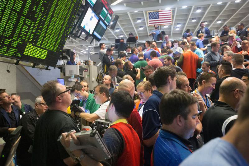 Traders works on the floor of the New York Stock Exchange after the Fed chose not raise interest rates on Sept.17 in New York. Traders had speculated for weeks over whether the Fed would raise rates or keep them at near zero percent interest.