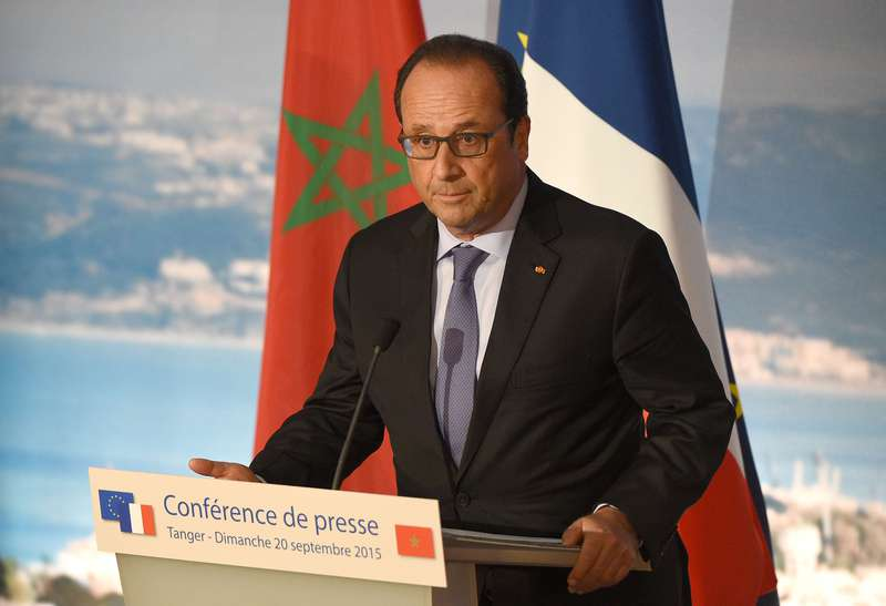 French President Francois Hollande holds a press conference at the Tanger-Med port on September 20, 2015, in the northeastern Moroccan coastal city of Tangier. (AFP Photo)