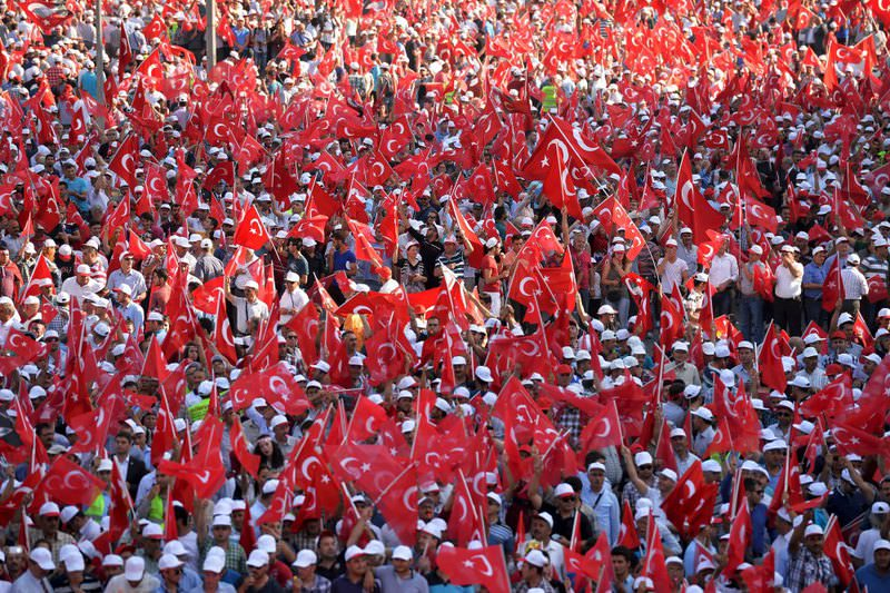 Thousands of demonstrators carry Turkey's national flag during a march against the PKK's continuing terrorist attacks on Turkish security forces and the civilians.