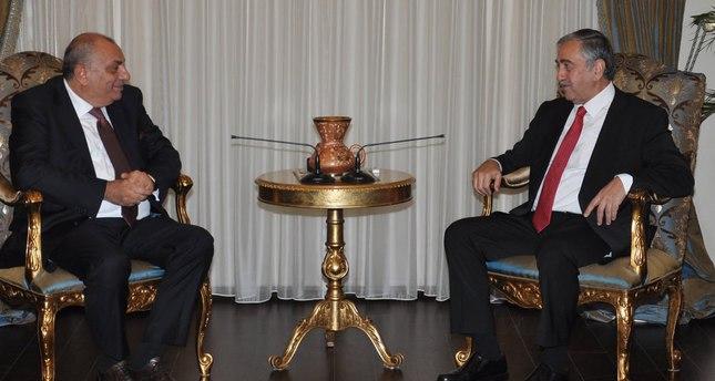 President of the Turkish Republic of Northern Cyprus Mustafa Akıncı (R) and Tuğrul Türkeş.