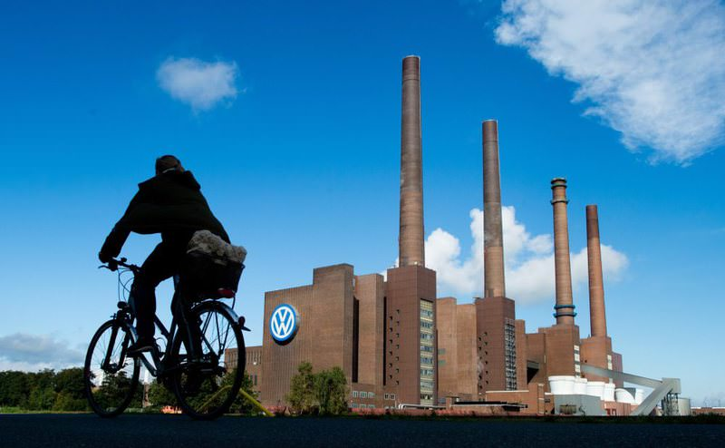 A cyclists makes her way past the Volkswagen plant in Wolfsburg, Germany.