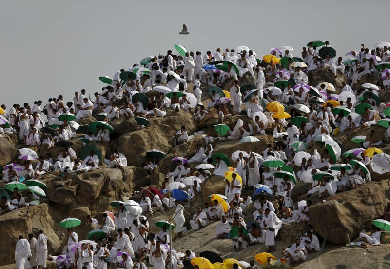 Muslim pilgrims pray on Mount Mercy on the plains of Arafat during the annual hajj pilgrimage, outside the Islamic holy city of Mecca.
