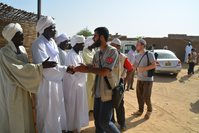 Turkey's Cansuyu relief association distributed meat to people in Darfur's Al-Fashir area in Sudan for Eidal-Adha on Sept 25, 2015. (AA Photo)