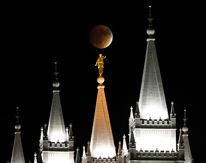 Earth's shadow obscures the view of a so-called supermoon during a lunar eclipse over the LDS Temple in Salt Lake City, Utah, Sunday, Sept. 27, 2015 (AP Photo)