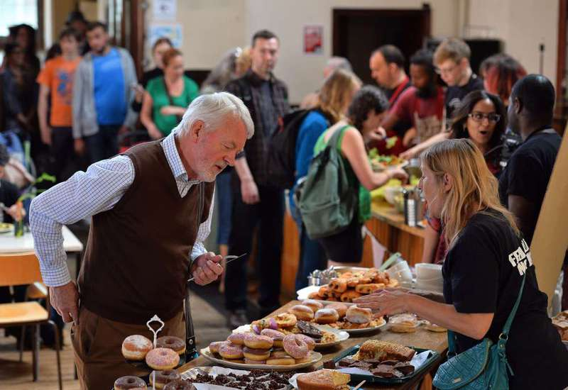 People eat at a Real Junk Food Project (RJFP) cafe in a church in Brighton on Sept. 11.